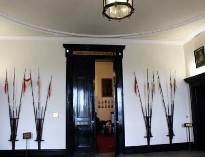 The entrance hall at Sandhurst showing two huge doors.