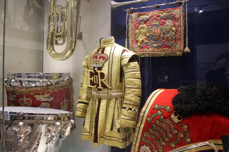 A display case in the Household Cavalry Museum with uniforms.