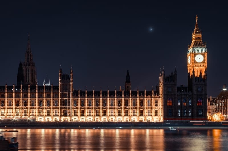 The Houses of Parliament lit up at night.