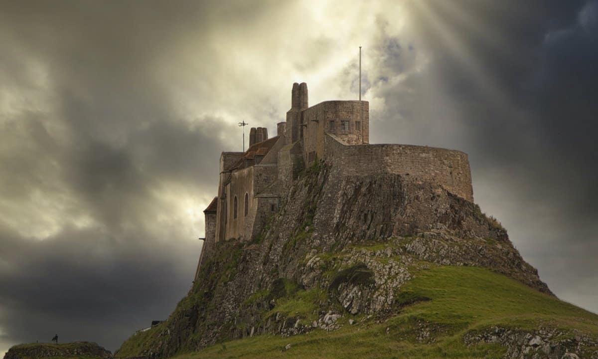 Lindisfarne Castle on the Holy Island set against a dramatic sky.