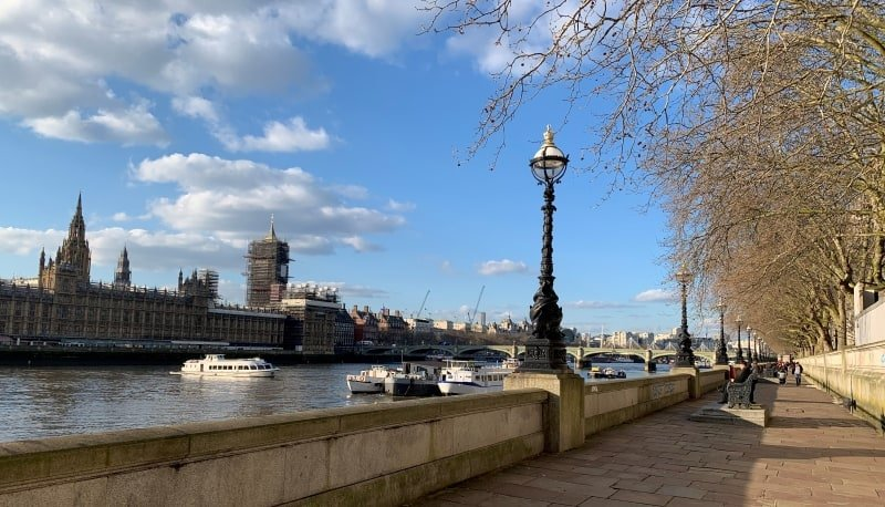 A view of the Houses of Parliament and the River Thames in London.