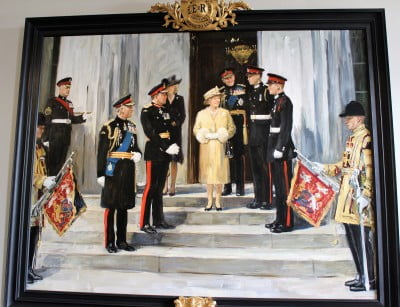 A close up of the portrait of the Royal Family at Sandhurst.