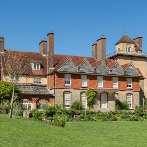 The exterior of Standen House on a sunny day.