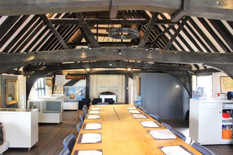 The inside of Aldeburgh Museum laid out for a council meeting.