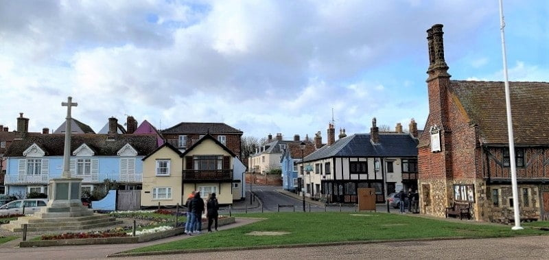 People walking around Aldeburgh by the sea front.