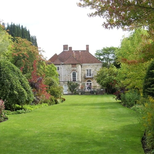 The home of Ted Heath in Salisbury showing the outside of his house and a large lawn.