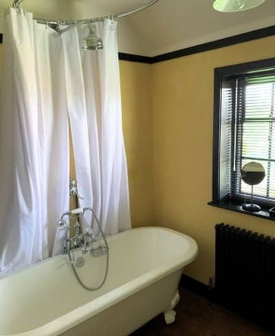 A roll top bath in the bathroom at the Vintage House.