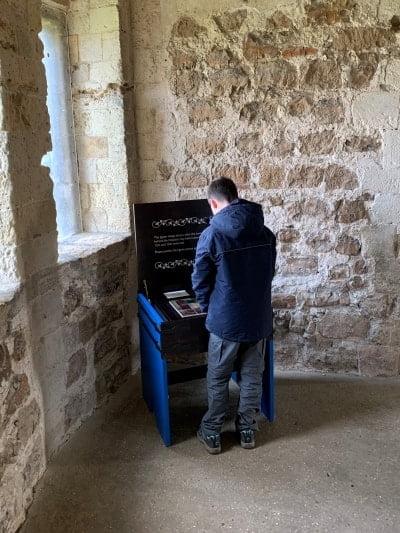 A boy doing a jigsaw in Orford Keep.