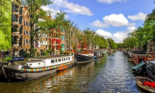 The historic canals of Amsterdam are listed as a UNESCO Heritage site.