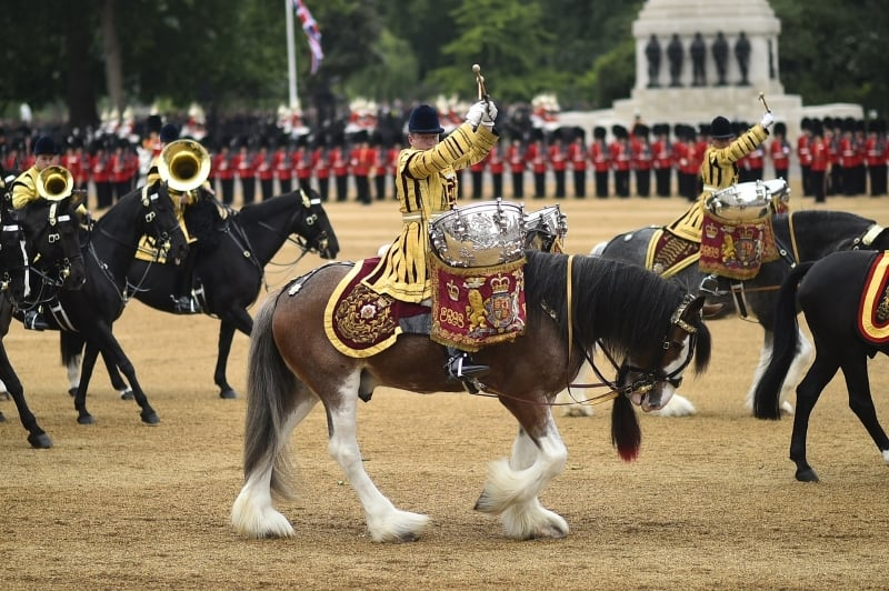 Troops in full ceremonial uniform on horse back in Horse Guards Parade.