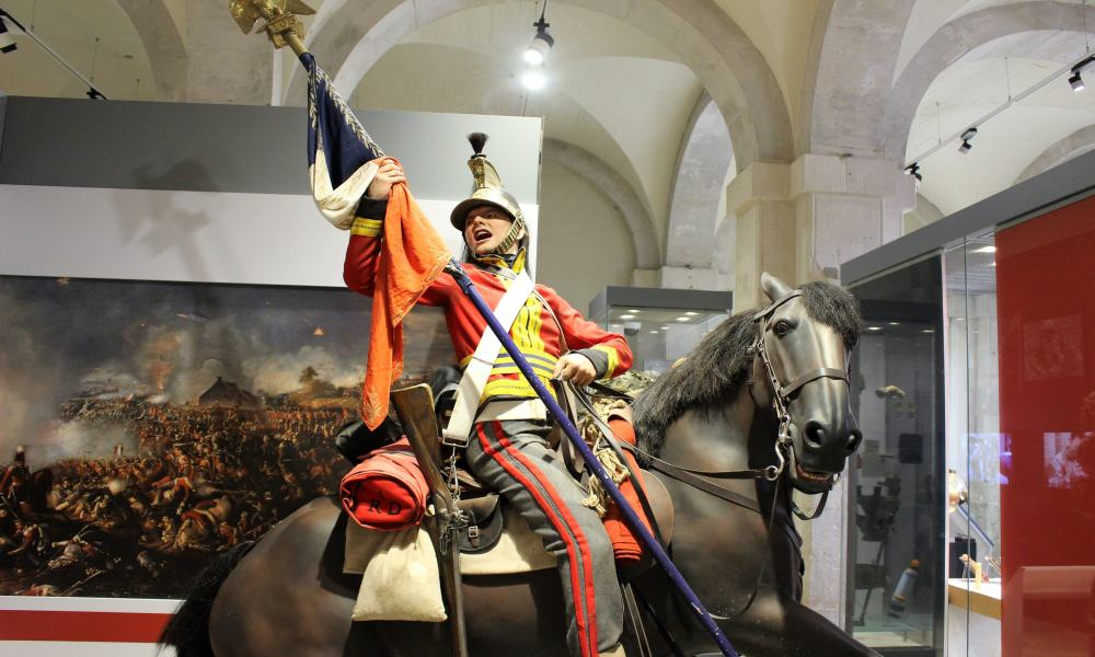 A model of a soldier on horseback waving a flag at the Household Cavalry Museum, London.