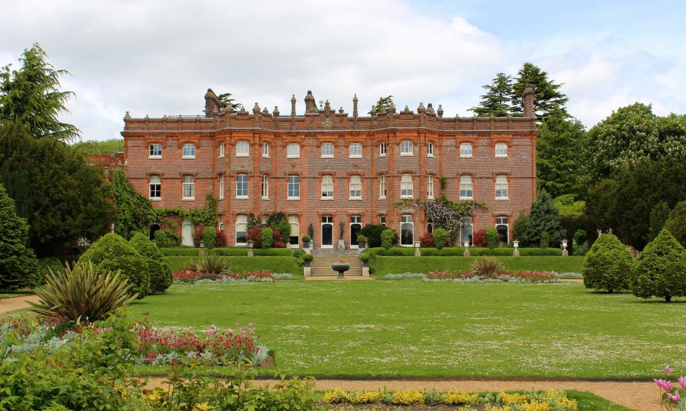 The outside of Hughenden Manor set in a beautiful gardens.