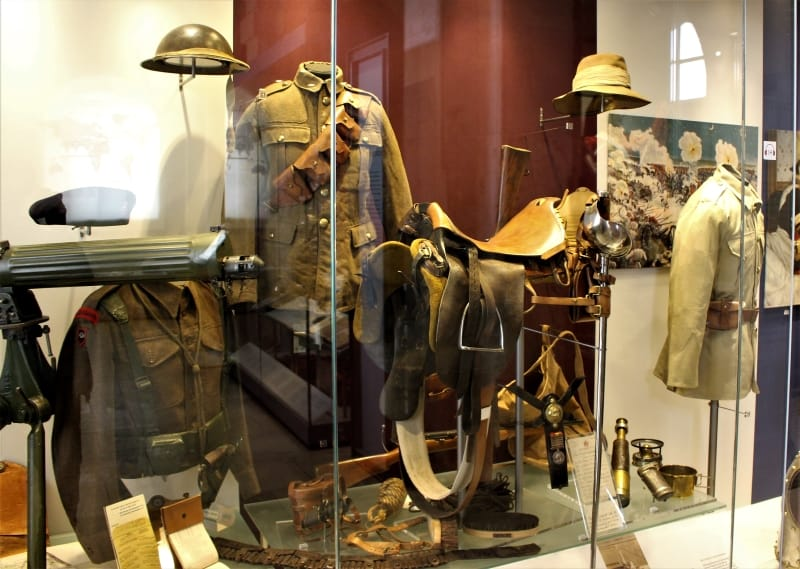 A display case containing 20th century uniforms at the museum.