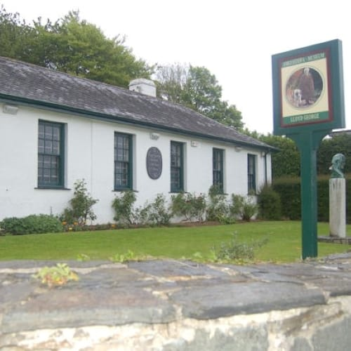The exterior of the Lloyd George museum in a small white building.