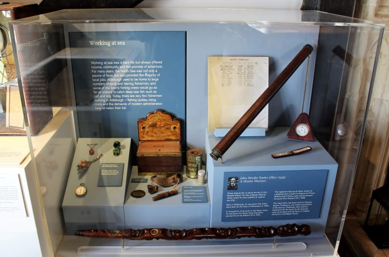 A display case containing items relating to sea faring in Aldeburgh Museum.