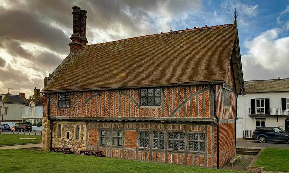 The exterior of the timer and brick tudor Moot Hall in Aldeburgh.