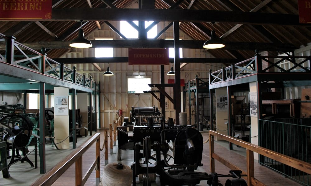 Inside the museum showing displays of machinery.