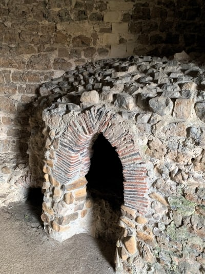 A stone oven inside Orford Keep.