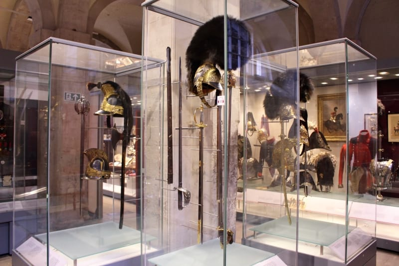 Display cases showing swords and helmets in the Household Cavalry Museum.
