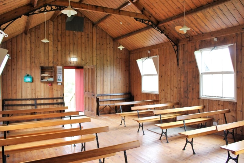 The wooden interior of a tin tabernacle church.