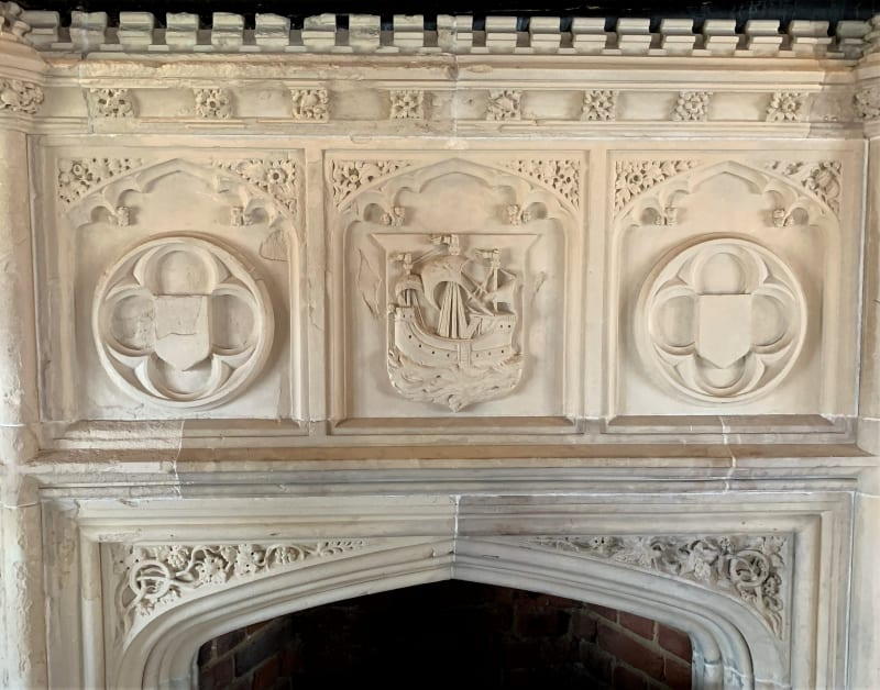 A close up of a Tudor fireplace in the Moot Hall.