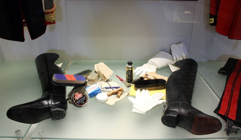 A display case fshowing the equipment used for cleaning the boots.