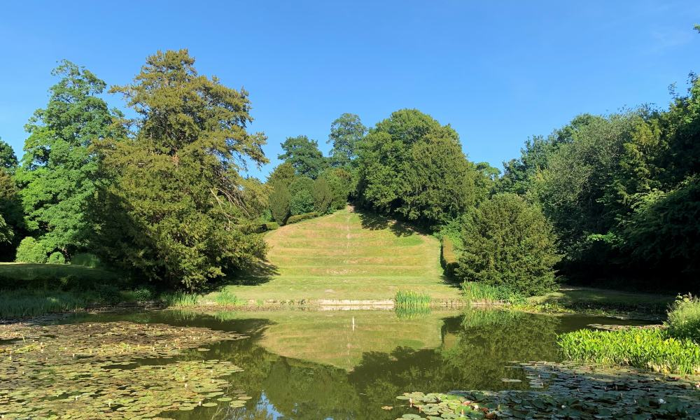 The grassed amphitheatre behind the lake in Downton Moot.