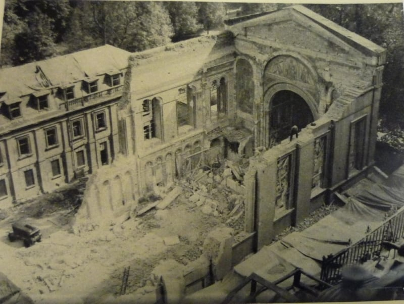 A black and white photo showing bomb damage to the guards Chapel.