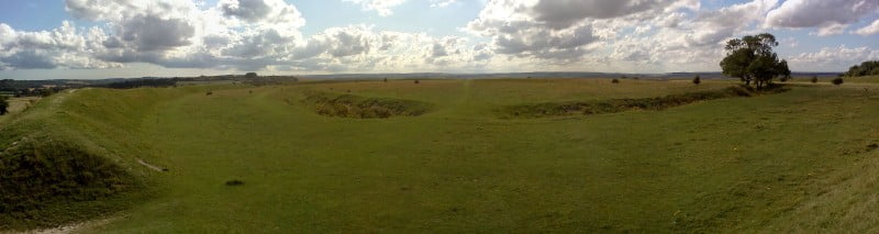A panoramic view of Figsbury Rings showing the ramparts and ditches.
