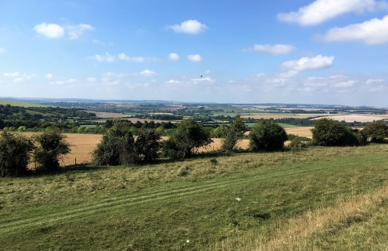 The views from Figsbury Ring over fields and villages.