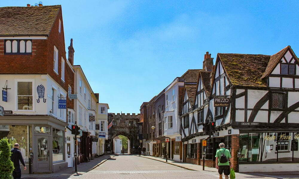 A view up the High Street in Salisbury, Wiltshire - with timber-framed buildings lining the road.