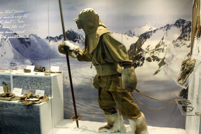A mannequin in polar gear leaning forward as if into the wind in the museum at The Wakes in Selborne.