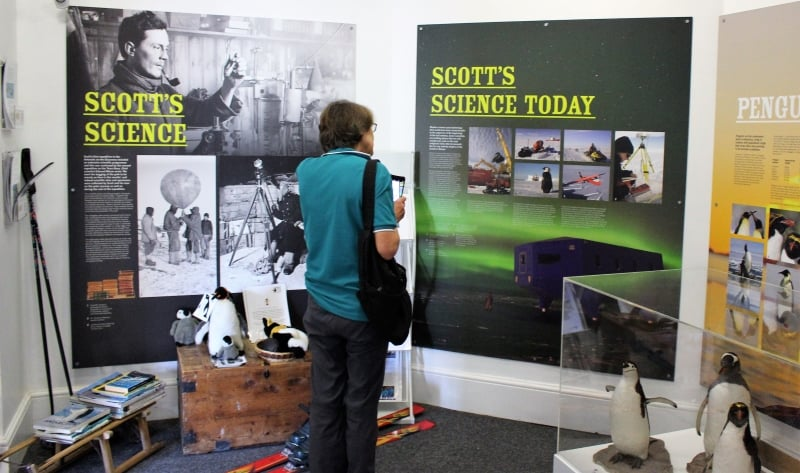 A person looking at a display saying Scotts Science.