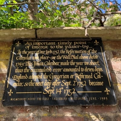 A close up of a sign outside Malmesbury House in Salisbury's cathedral close.