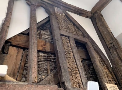 A close up of a wattle and daub window inside a shop in Salisbury.