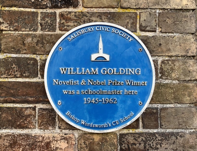 A close up of the blue plaque to Willaim Golding who was a school teacher in Salisbury.
