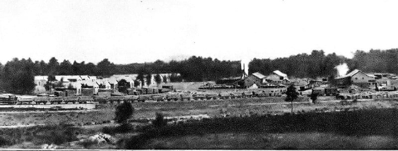An old black and white photo of a Canadian sawmill in the New Forest.
