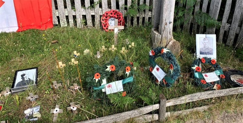 Poppy wreaths and crosses on the grass at the Canadian War Memorial in the New Forest.