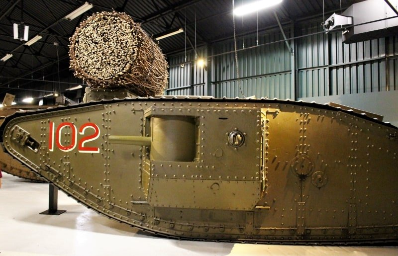 A  tank with a huge bundle of sticks on top on display at the Bovington Tank Museum in Dorset.