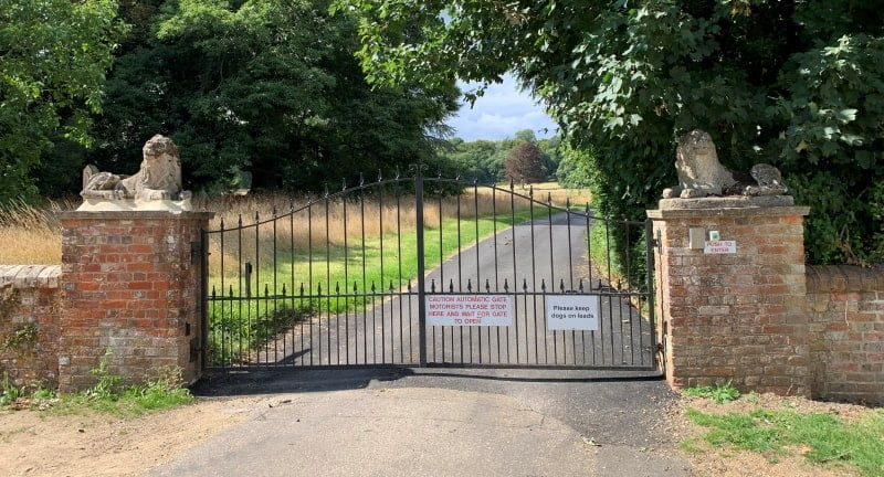 The gates to Breamore House provide the access to the footpath which leads to the Mizmaze.