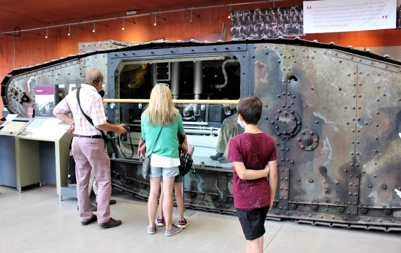 A Mark Two tank with a side cut away showing mannequins inside and the engines.