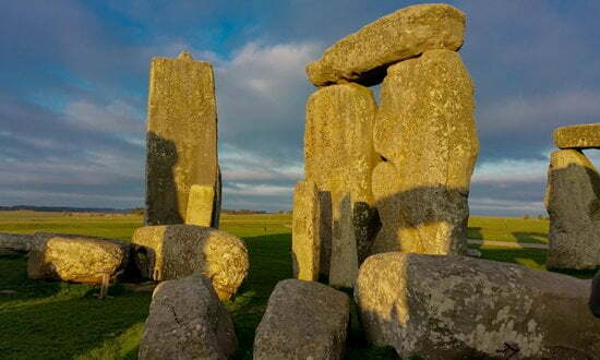 Inside the World Heritage listed stone circle of Stonehenge at dawn.