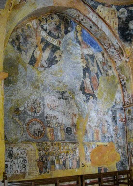 One of the walls of the nave in St. John the Theologian Church covered in frescoes.