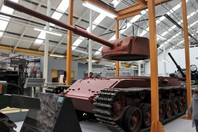 A re-creation of a tank factory showing a turret being lowered onto a tank.
