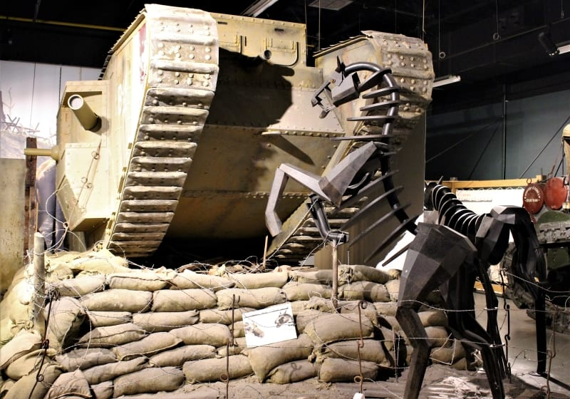 A model of a warhorse rearing in front of a tank.