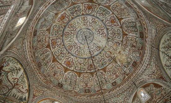 The decoration on the ceiling of a dome in a mosque, Albania.
