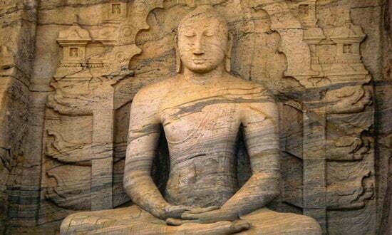 A rock carving of a Buddha meditating, Sri Lanka.