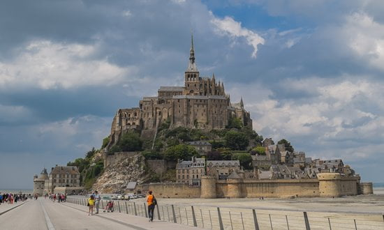 Walking on to the tidal island of Mont Saint Michel, France.
