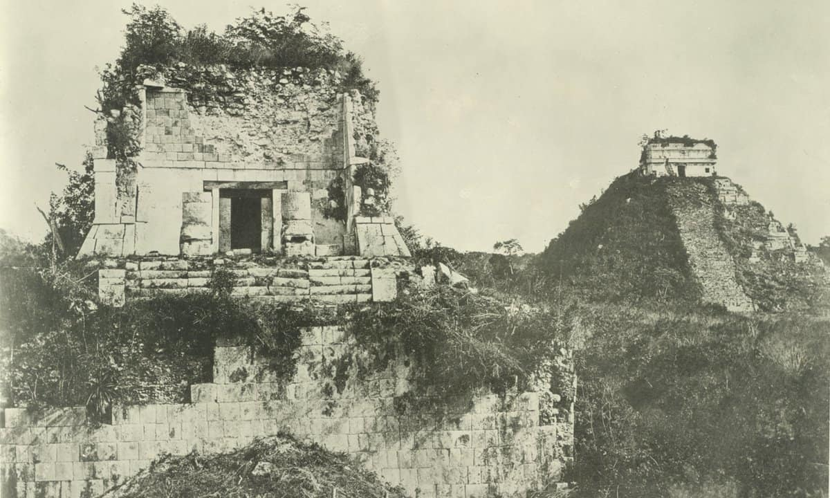 Overgrown Chichen Itza as seen in a photograph from around 1895.