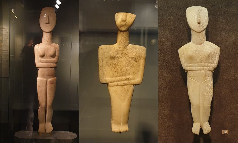 Three typical Cycladic figurines in the Museum of Cycladic Art in Athens.